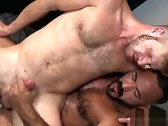 Gay hunk giving blowjob