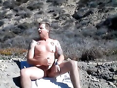 Stroking my cock at the beach.