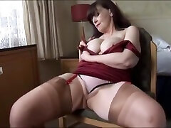 Big tits ages ames milf shows off sheer panties and stockings