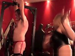 Teasing topless femdoms in latex flogging sub