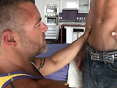 Hunk is stuffing gay chap with dildo before anal job