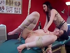 Tied up babe anal fucked in tattoo shop