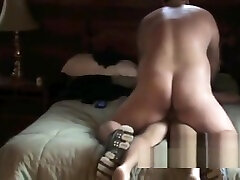 Bear pounding cub into bed