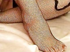 Stripteasing And Masturbating Brunette