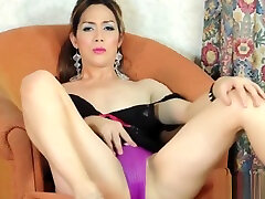 Asian ladyboy toying her ass with dildo