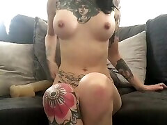 Tattooed babe fucks her pussy with huge dildo