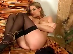 Glamour babe strips then rubs her pussy while wearing lingerie