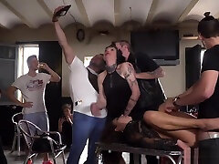 Bound brunette humiliated in bikers shop