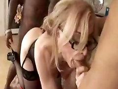 Mature legendary pornstar working on two huge black cocks