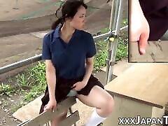 Japanese teen schoolgirl rubs her pussy over her panties