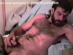 Rugged and Hairy Man Stroking Out His Cum