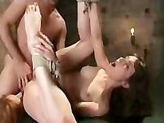 Guy anal fucks two bound babes in dungeon