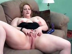 Mature wife plays on couch