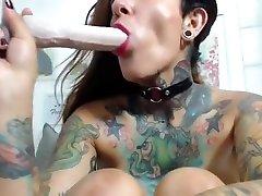 Heavily Tattooed Woman Fingering Herself