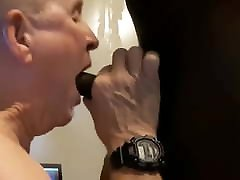 Old man on his knees sucking and eating cum from black cock
