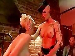 Tranny gets blowjob from bondage girl