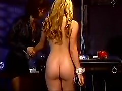 Lesbian babes using titty clamps and toys