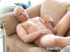 Horny guy strips and strokes his dong