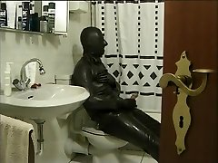 Latex Encased Person Masturbating on Toilet