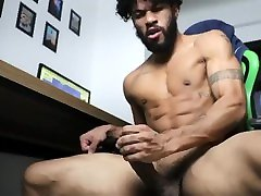 Hot hunk licking his own cum