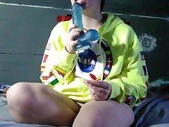 Tranny plays with massive dildo