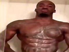 Black male stripper showering