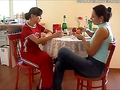 2 Russian chicks get drunk and horny in the kitchen