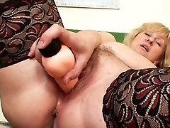 Busty suoki susu teacher fucks herself with a dildo