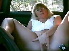 Mature lady masturbating in the car while dogging