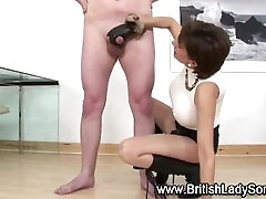 Mature lady gives leather gloved handjob to younger guy