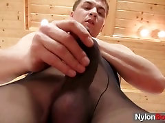 Jack is jerking off his cock and plays with balls in nylons