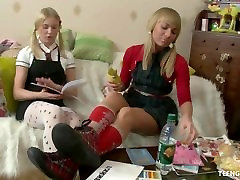 Gorgeous blonds with pigtails fuck each other with a strap on