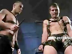 Two submissive men are bound in sexe freind and dominated by a gorgeo