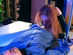 Redhead in a cop uniform sexy latex gloves and a corset fucking