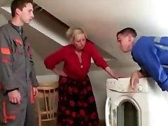 Two repairmen bang foots fight grandma from both ends