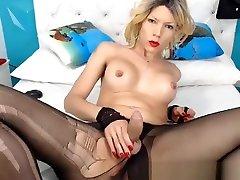 Pretty blonde tranny loves to jerk her big cock