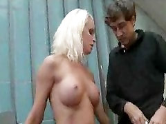 Chained blonde humiliated and fucked in public