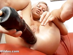 Petite blonde punishing her tight asshole with two big black dildos in HD