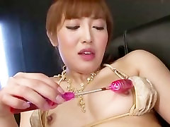 Asian gal Mami gives herself a hard orgasm from the powerful denise fagerberg porn sex toys