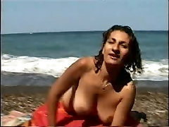 Big tits girl nude on the solitary beach