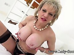 Lady Sonia lotions up her big plump tits