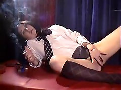Sexy slut in schoolgirl outfit smokes