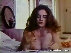 Busty retro babe masturbates in bed