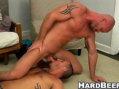 Bald muscular hunk gets his dick sucked