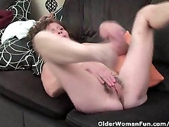 Skinny granny in stockings gives her hairy old pussy a treat