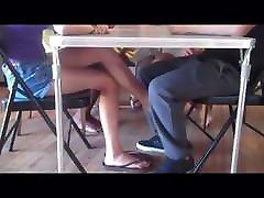 Under the table footjob and handjob