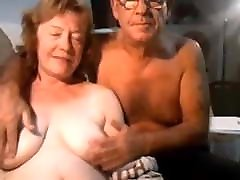 Mature MILF blows her hubby on cam older couple
