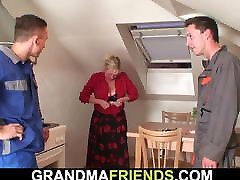Old grandmother spreads legs for two men