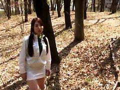 Japanese girl in orange lantti rites eaten out