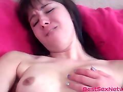 Tantalizing babe shows how horny she is by toying her pussy